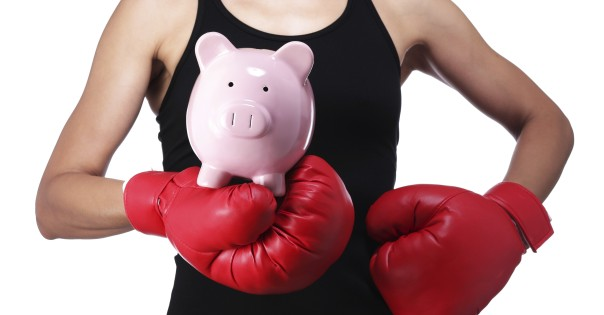 photograph of a bust of a woman boxer with a piggy bank