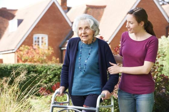 Helping Senior To Use Walking Frame